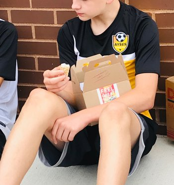 soccer player eating snack pre game